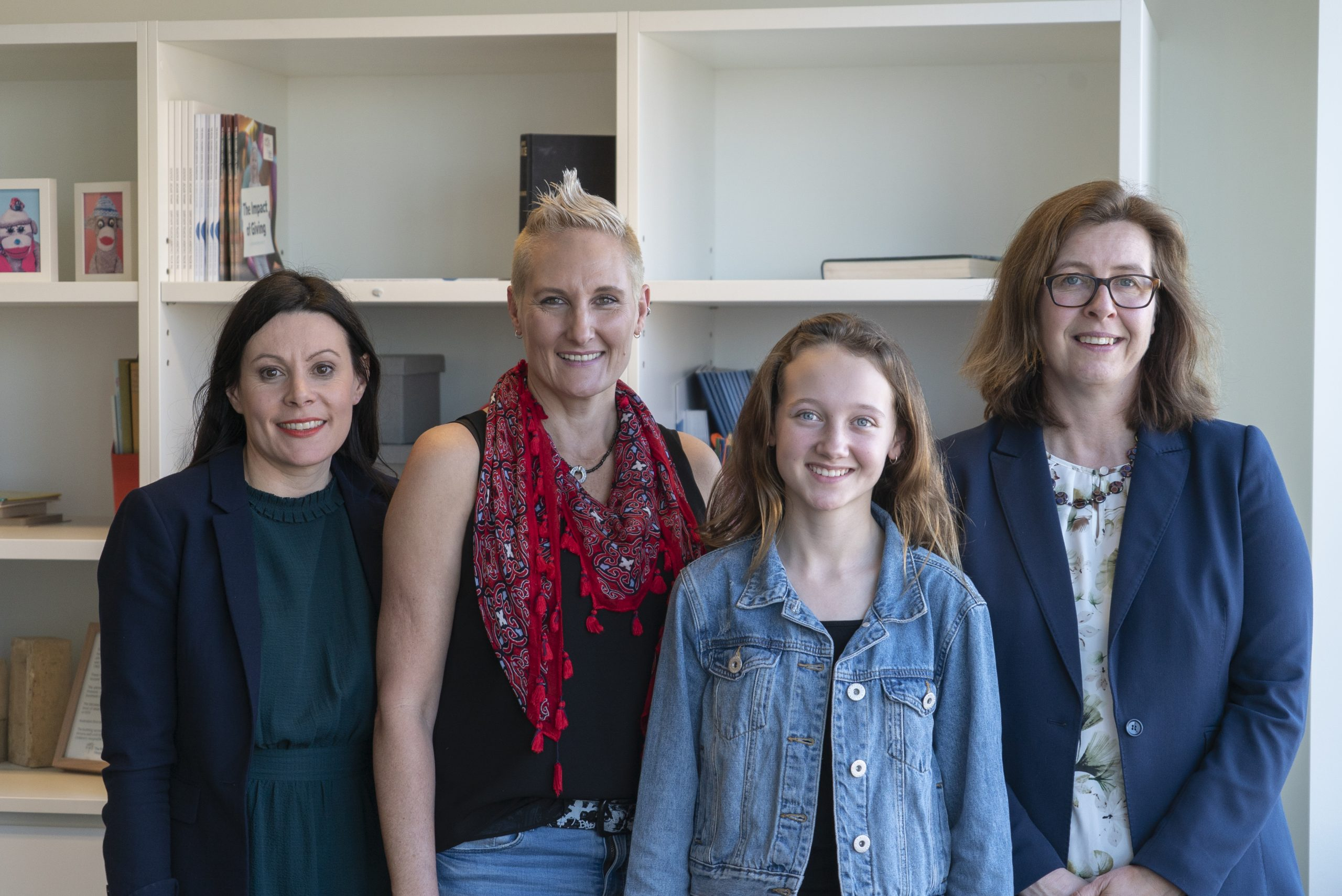 Participant Sian with Mum Azelene (centre), and study investigators Prof Angela Morgan (left) and Prof Melanie Bahlo (right).